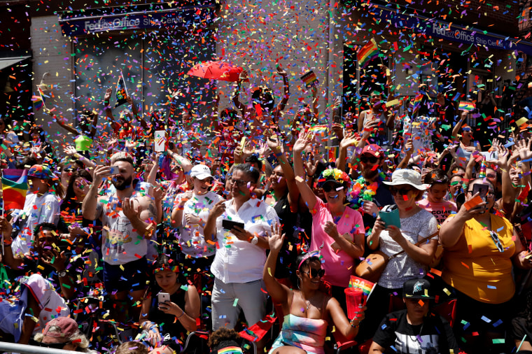 Image: Confetti falls as people watch the New York Pride March on June 30.