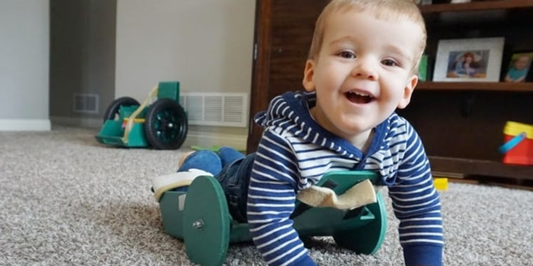 "Brody Moreland, who has spina bifida, using a ""Frog"" device designed by his father"