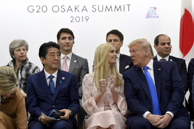 Image: President Donald Trump, right, leans over to talk to Ivanka Trump as they sit next to Japanese Prime Minister Shinzo Abe during a G-20 summit event on women's empowerment in Osaka, Japan