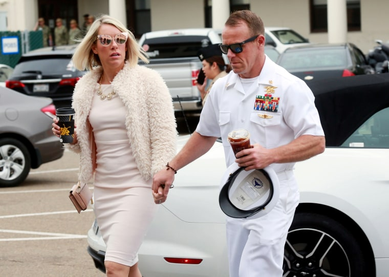 Image: Navy Special Operations Chief Edward Gallagher walks into military court with his wife, Andrea Gallagher, in San Diego on June 24, 2019.