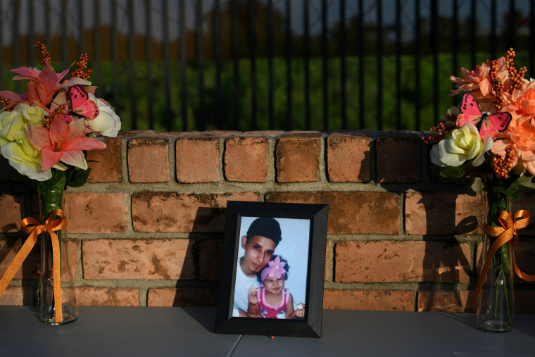 Image: A photo of Oscar Alberto Martinez Ramirez and his 23-month-old daughter, Valeria, who drowned while crossing the Rio Grande, at a vigil in Brownsville, Texas, on June 30, 2019.