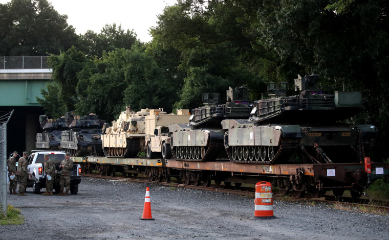 Image: M1A1 Abrams tanks and other military vehicles sit on rail cars in Washington, D.C., on July 2, 2019. President Trump requests military hardware for Independence Day celebrations on the National Mall.