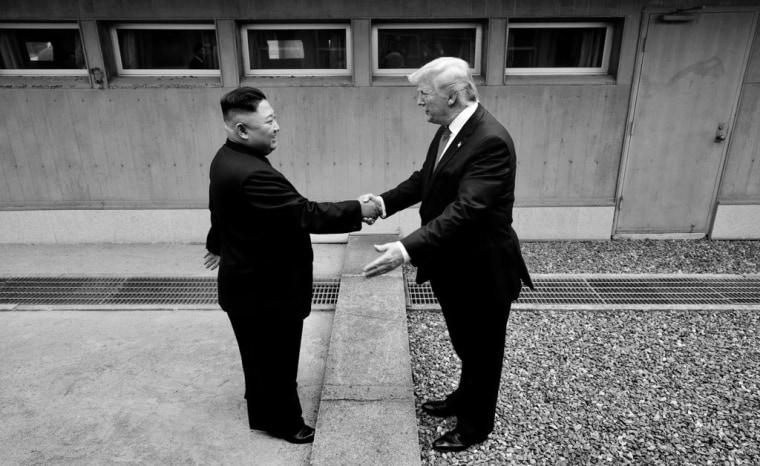 Image: President Donald Trump and North Korean leader Kim Jong Un shake hands at the demilitarized zone separating North and South Korea on June 30, 2019.