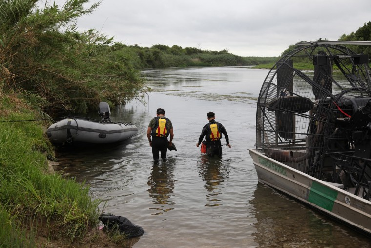 Image: Del Rio Sector Border Patrol agents lead search for missing 2-year-old Haitian girl in Rio Grande River.