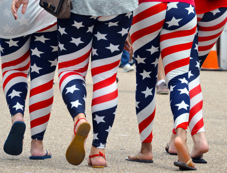 Women wear U.S. flag leggings on Pennsylvania Avenue in Washington