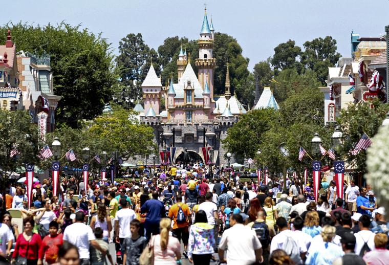 Image: Patrons walk in front of Sleeping Beauty Castle at Walt Disney Co.'s Disneyland amusement park in Anaheim