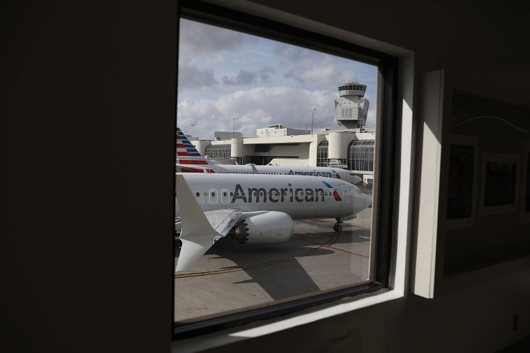Image: An American Airlines Boeing 737 Max 8 pulls into its gate after arriving at the Miami International Airport from LaGuardia Airport
