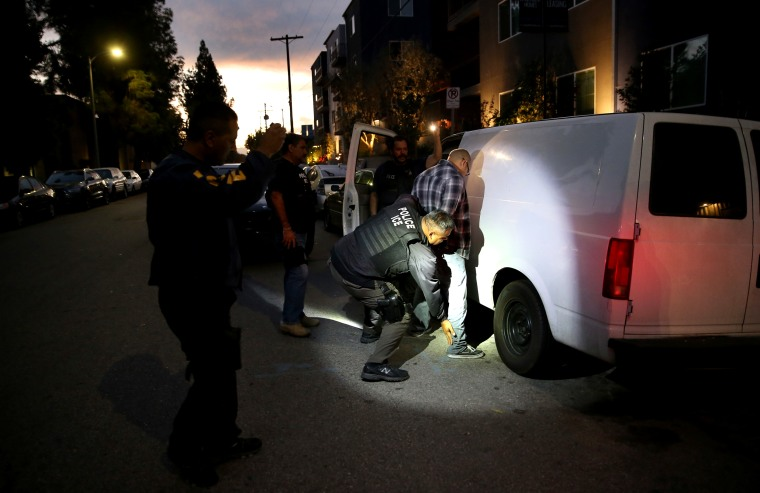 Image: A man is detained by Immigration and Customs Enforcement agents in Los Angeles on Oct. 14, 2015.