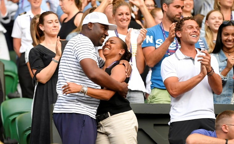 Image: Corey and Candi Gauff celebrate after their daughter Cori Gauff of the U.S. won her third round match against Slovenia's Polona Hercog