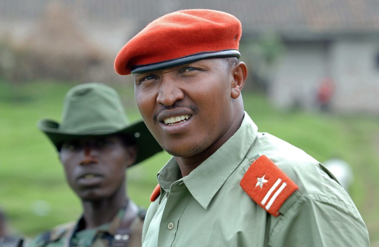 Image: General Bosco Ntaganda, self declared leader of the National Committee for the Defense of the People (CNDP), escorted by comrades at his mountain base in Kabati, Democratic Republic of Congo