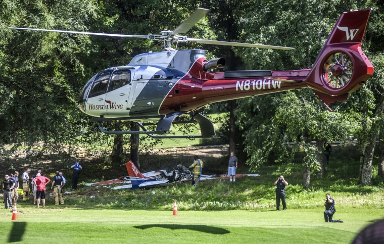 Image: A medical helicopter lifts off following a plane crash on the Ole Miss Golf Course in Mississippi on July 6, 2019.