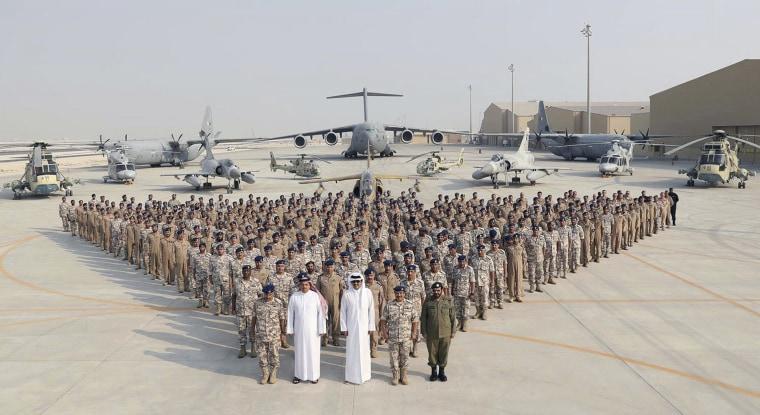 Qatari Emir Sheikh Tamim bin Hamad Al-Thani, center front, visits Al Udeid Air Base on Sept. 11, 2017.