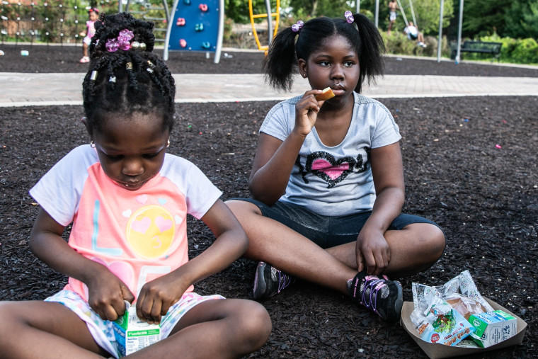 Nhyira Appiah, right, eats her meal at Rowley Park in East Orange.