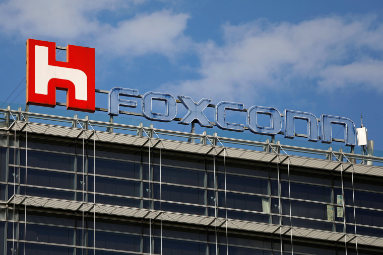 Image: The logo of Foxconn, the trading name of Hon Hai Precision Industry, is seen on top of the company's building in Taipei