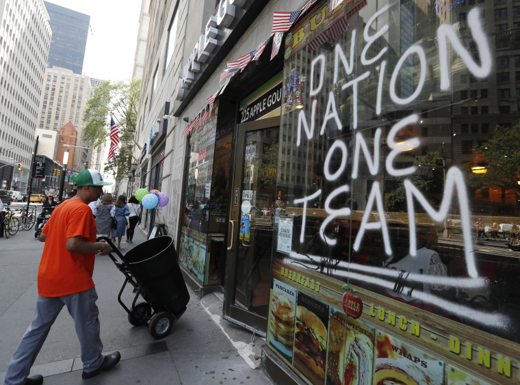 Image: A spray-painted sign honors the four-time World Cup winning U.S. women's soccer team, one day ahead of a ticker-tape parade and City Hall ceremony honoring their latest achievement,