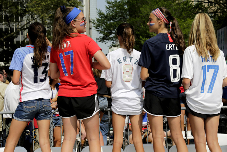 Image: Fans wear jerseys bearing the names of U.S. women's soccer team players at City Hall in New York on July 10, 2019.