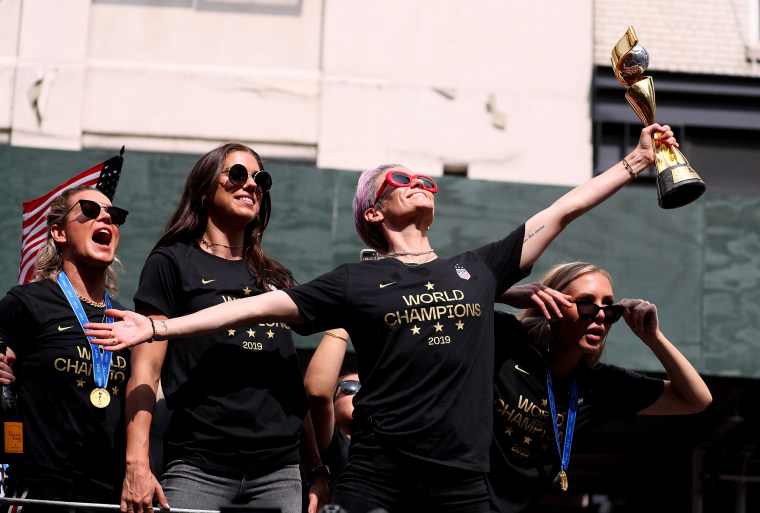 Image: Megan Rapinoe strikes her signature pose atop a celebratory float in New York on July 10, 2019.