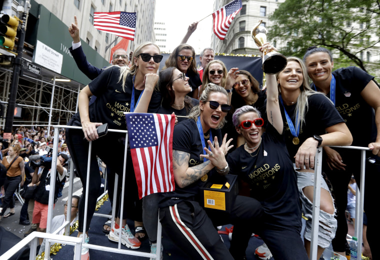 Image: The U.S. women's soccer team celebrates with the World Cup trophy as their float travels up the Canyon of Heroes in New York on July 10, 2019.