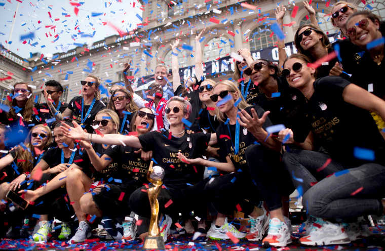 Image: The U.S. women's soccer team poses with the World Cup trophy at City Hall in New York on July 10, 2019.