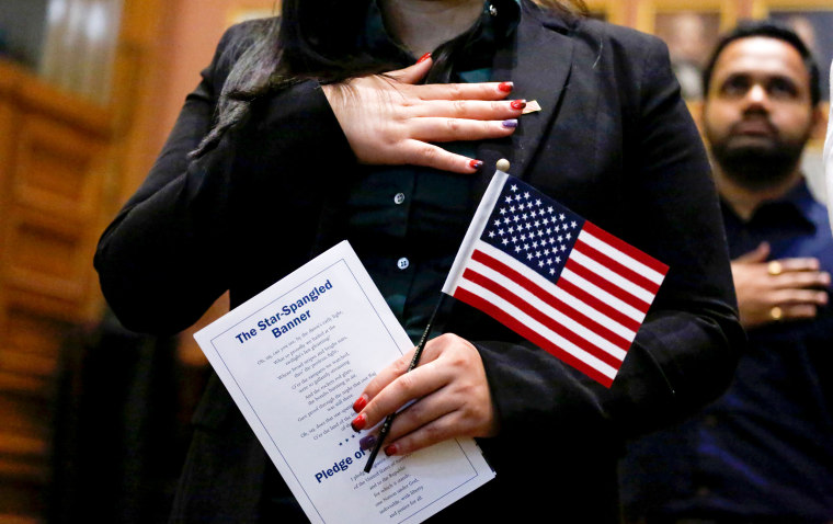 Image: A candidate for citizenship during a naturalization ceremony in Jersey City, New Jersey, on Feb. 22, 2017.