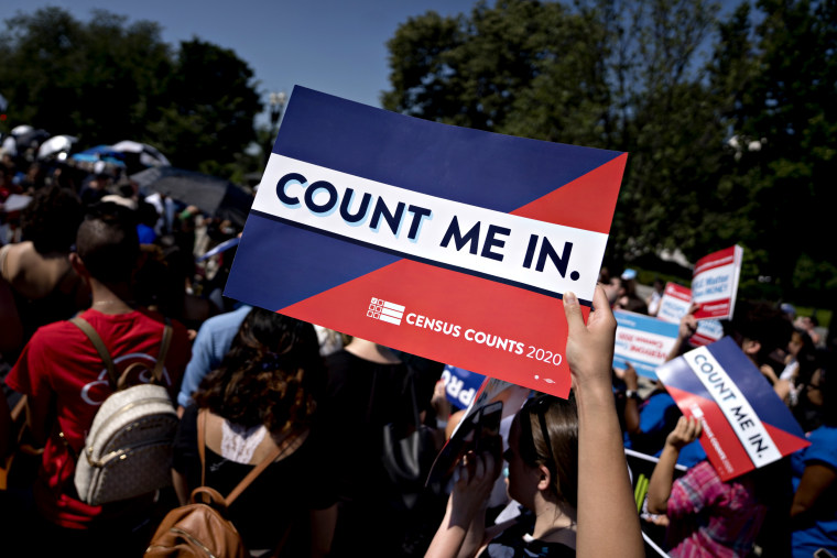 Image: A demonstrator holds a sign denouncing a Trump administration plan to add a citizenship question to the census outside of the Supreme Court on June 27, 2019.