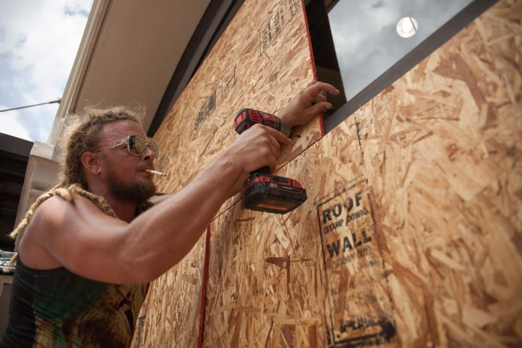 Image: Matt Harrington boards up a Vans shoe store near the French Quarter in New Orleans as tropical storm Barry approaches