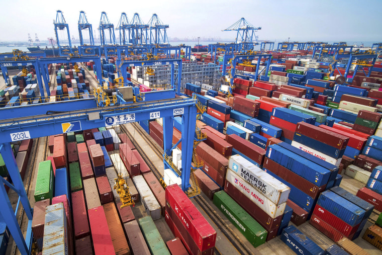 Image: Containers are piled up at a port in Qingdao in east China's Shandong province.