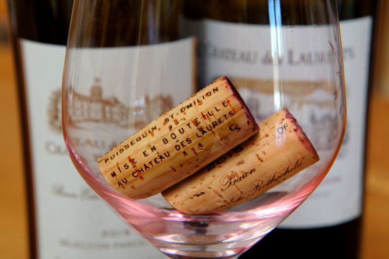 Image: Cork wine stoppers in a wine glass after a tasting of Chateau des Laurets wines at the estate in Saint-Emilion