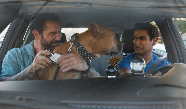 "Dave Bautista as Vic, Pico the Pibble, and Kumail Nanjiani as Stu in ""Stuber."""