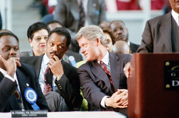 Image: Rev. Jesse Jackson listens to Bill Clinton at a convention in Atlanta on Sept. 9, 1992.