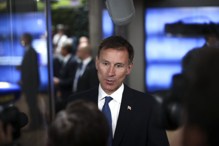 Image: Britain's Foreign Secretary Jeremy Hunt talks to journalists as he arrives for a European Foreign Affairs Ministers meeting at the European Council headquarters in Brussels