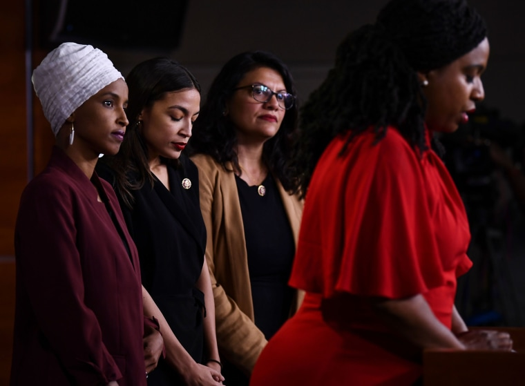 Image: Representatives  Ilhan Omar, Alexandria Ocasio-Cortez, Rashida Tlaib and Ayanna Pressley attend a press conference to address remarks made by President Donald Trump.