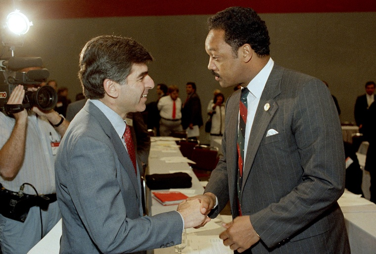 Image: Massachusetts Governor Michael Dukakis shakes hands with Rev. Jesse Jackson in Nashville in 1987. Jackson would be right on the heels of Dukakis during the following years presidential election.