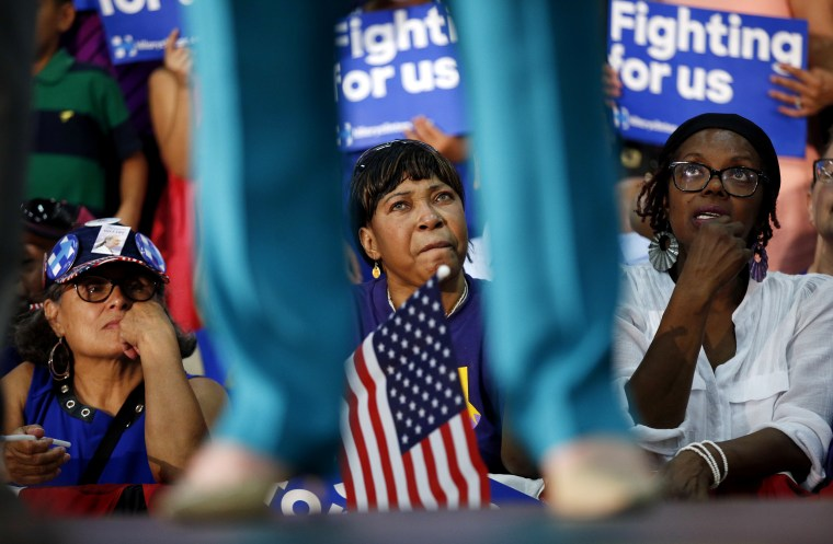 Image: People listen as Hillary Clinton speaks at a campaign rally in Fresno, California, on June 4, 2016.