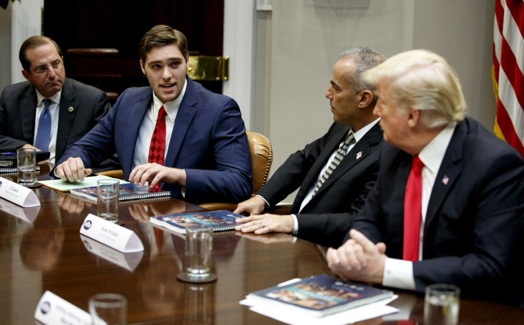 Image: JT Lewis, left, the brother of Sandy Hook victim Jesse Lewis, speaks to President Donald Trump during a round table discussion on school safety at the White House on Dec. 18, 2018.