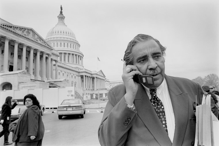Image: Charles Rangel talking on mobile phone