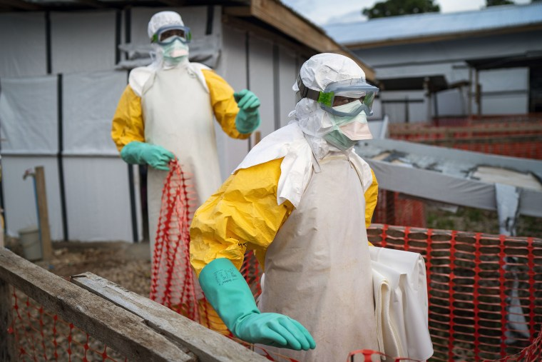 Image: Health workers wearing protective suits take their shift at a treatment center in Beni, Democratic Republic of the Congo
