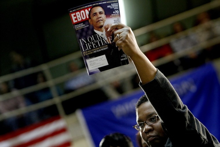 Image: A woman holds a copy of Ebony magazine featuring Barack Obama at the Waukesha County Exposition in Wisconsin in 2008.