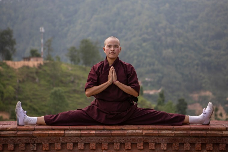 """While many of the Himalayan Buddhist nuns like Jigme Karuna Chosdon joined at a young age, there is no age limit and the call to faith is always a personal choice. Some have left jobs as policewomen, teachers and veterinarians - with 25 new girls joining the Nepalese nunnery last year alone. Soft spoken and yet confident in her testimony, the journey to faith of 29-year-old Jigme Migyur Palmo is echoed by many: \""""When his Holiness the Gyalwang Drukpa came to our village and talked about how important girls are, and how important it is to provide equal opportunities, I was very inspired.\"""" His Holiness was the first to put Buddhist nuns in positions of leadership, in an effort to shift of power dynamics - and gave teachings meant only for monks. \""""From then, I decided to become a nun.\""""   The Durkpa lineage of the Himalayan Buddhists is led by a monk known as His Holiness the Gyalwang Drukpa, who rewrote the rules about females being seen as second-class citizens and gave nuns leadership"""