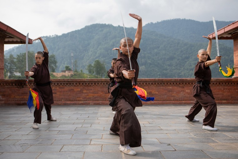 """In the process of being indoctrinated as a Himalayan Buddhist nun, an electric razor skims the scalp of each woman shortly before maroon robes are donned. """"Hair is our most treasured jewel as a woman,"""" confesses Jigme Yeshe Lhamo, one of the longest-serving nuns at Druk Gawa Khilwa Nunnery. """"Our head is shaved though to break this deep attachment."""" In its place, the women search for internal purpose and satisfaction. Cycling from Kathmandu, Nepal to Ladakh, India over a period of three months they stopped at every remote village possible. """"Sometimes we stayed in gurdwaras, sometimes we stayed in temples, and sometimes we stayed on Muslim ground near a Masjid,"""" recalled Lhamo. When language became an obstacle, they went to journalists and media to communicate their messages on their behalf: """"If we can ride bicycles, your daughters can farm,"""" they would say. """"They are worth keeping!"""""""