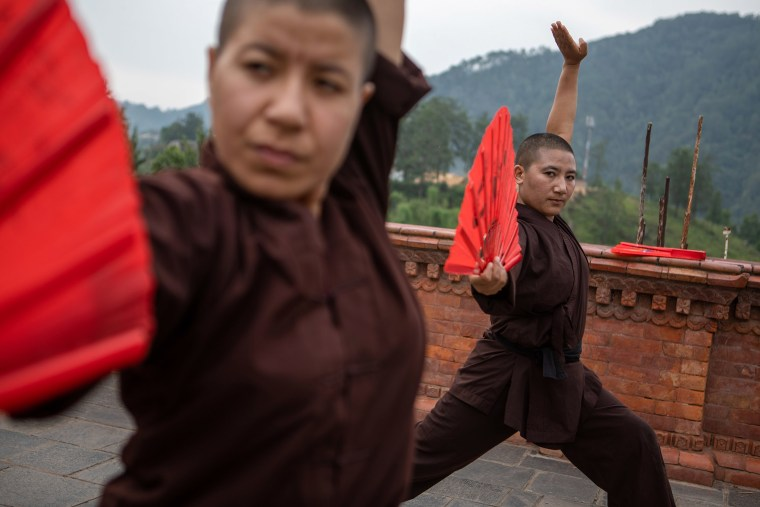 """Today, the nuns are seen as local heroes and respected by Muslims, Hindus and Buddhists alike, practicing the sport every evening in their monastery shortly before sunset, after starting the day at 3am. Girls are learning the words 'molestation' and 'rape' for the first time, as the nuns transcend all religious and cultural barriers though self-defense workshops - teaching nearly 400 girls to date. \""""We do not choose the girls; whoever wants to come can,\"""" explains Lhamo. There are of different religions and backgrounds,\"""" explains Lhamo, stressing the importance of removing any and all religious elements. \""""Once the religion comes in, there are too many restrictions and hurdles. We do not spread Buddhism, we spread humanity.\"""""""