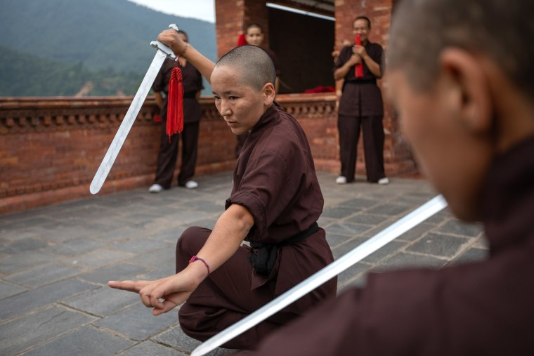 """Fully immersed in concentration, Kung Fu and meditation are not so different. With so many misconceptions surrounding Buddhism and the sport, """"We try to make people understand is that Kung Fu is not for violence, it is for self-defense - to become more confident and stronger,"""" admits Lhamo. """"In meditation you have to have the whole of your mind in one place, concentrating. It is the same in Kung Fu, or you could get hurt."""""""