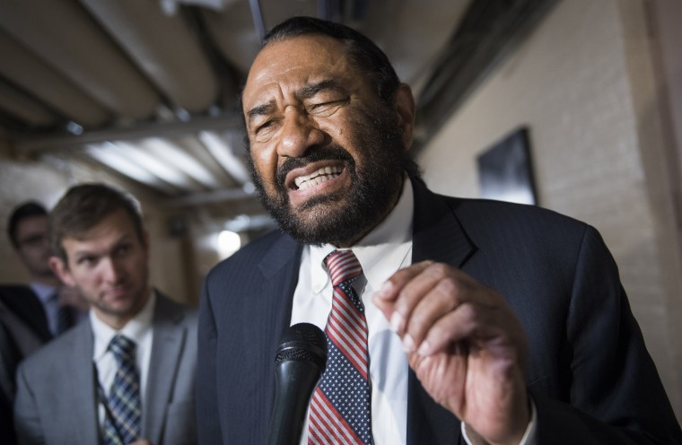 Rep. Al Green, D-Texas, talks with reporters after a meeting of House Democrats at the Capitol