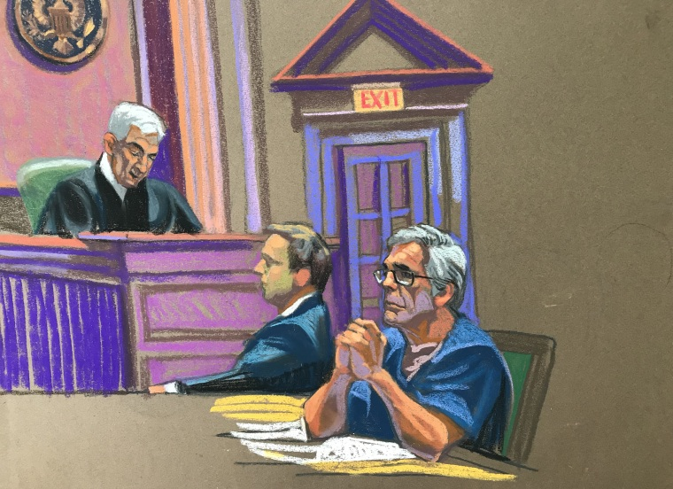 U.S. financier Jeffrey Epstein looks on near Judge Richard Berman during a bail hearing in his sex trafficking case in New York on July 18, 2019.