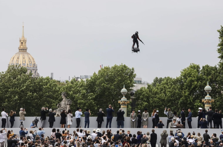 """Image: Zapata CEO Franky Zapata flies a jet-powered hoverboard or \""""Flyboard\"""" prior to the Bastille Day military parade down the Champs-?lys?es"""