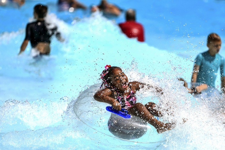 Image: Destinee Lucas, 6, of Aliquippa, rides a wave at the pool at Settlers Cabin Park, Thursday, July 18, 2019, in Robinson, Pennsylvania.