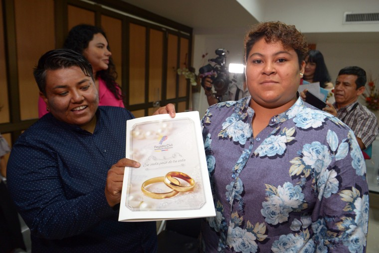 Image: Alexandra Chavez, left, and Michelle Aviles celebrate being married during Ecuador's first same sex marriage at a registry office in Guayaquil o