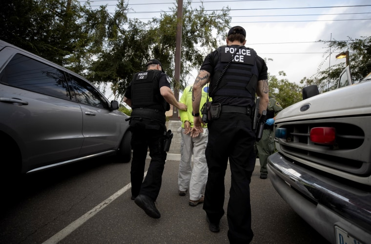 Image: U.S. Immigration and Customs Enforcement officers arrest a man during an operation in Escondido, California, on July 8, 2019.