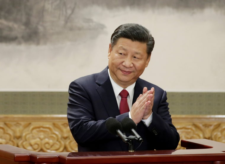 Image: China's President Xi Jinping claps after his speech in Beijing