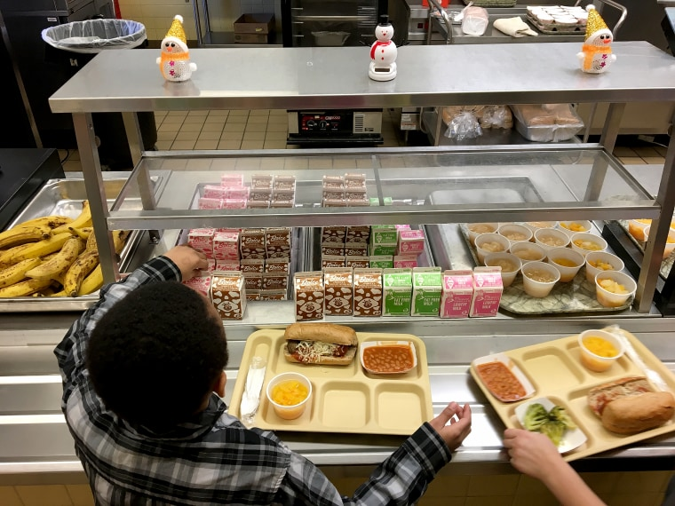 Students fill their lunch trays at J.F.K Elementary School in Kingston, New York on Jan. 25, 2017.